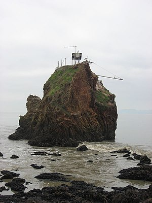 Red Rock Island - Abandoned Coast Guard fog bell on southern point of island