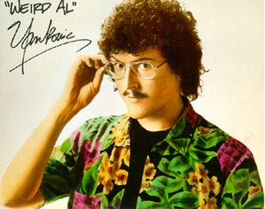 """Weird Al"" Yankovic - Yankovic's ""classic"" look before eye surgery: with glasses, mustache and short, curly hair; used from 1979 to 1998"