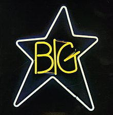 "A white neon star with the word ""BIG"" in neon yellow in the middle"