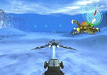 A horizontal rectangular video game screenshot that is a digital representation of a snow covered planet. Centered in the lower portion is the rear of a grey, triangular space ship. A green, white, and red icon in the upper right corner partially covers a brown and yellow alien creature.