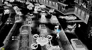 Tom Clancy's Ghost Recon: Future Soldier - Kozak uses a drone to scout out enemies in the Pakistan streets. Here the screen is gray to show the perspective of the streets from the UAV camera.