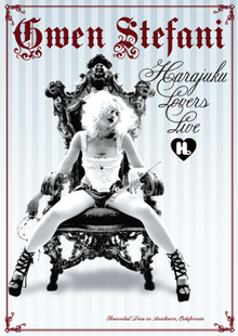 "The cover shows a black-and-white image of a blonde lady wearing a white lacy vest top, small denim shorts and black high-heeled shoes sitting on a throne, leaning forwards with her legs spread wide, in front of a blue-and-white vertical-striped background. The words ""Gwen Stefani"" in purple text are above her and the words ""Harajuku Lovers Live"" in black italic text are to her left. The words ""Filmed Live in Anaheim, California"" are across the bottom in purple italic text."