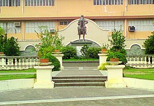Wesleyan University Philippines - Statue of John Wesley stands prominently at the J.W. Park adjacent to the Administration Building.