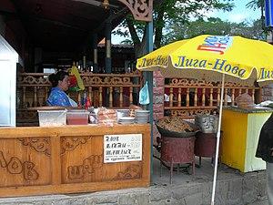Crimean Tatar cuisine - Crimean Tatar food stall on the beach in Koktebel: pilaw (pilaf), manty, shashlik.