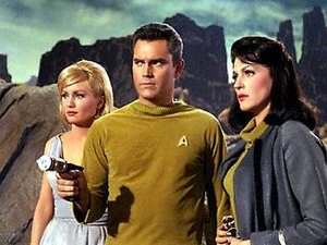 Star Trek uniforms - The original concept of the Starfleet uniform as worn by Captain Christopher Pike was different from what eventually became the standard design. Men are in ribbed turtlenecks and women in cowl neck variations. Both had a gray jacket