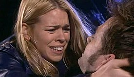 Rose Tyler (Billie Piper) cradles a dying Doctor (David Tennant) after he has been shot by a Dalek gunstick.