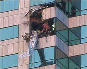 2002 Tampa airplane crash - The plane's tail hangs from the Bank of America building in Tampa, Florida.