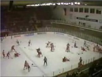 Punch-up in Piestany - Players from both teams fighting over the entire ice surface.
