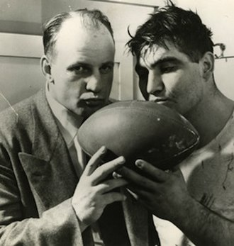 Bob Voigts - Voigts and Northwestern center Alex Sarkisian kiss the game ball after winning the Rose Bowl in 1949.