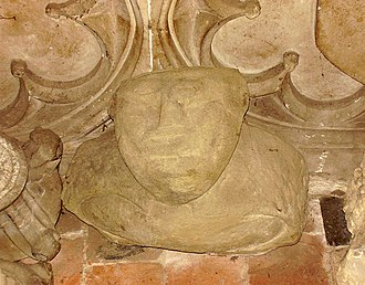 Great Malvern Priory - An ancient carved head and shoulders was excavated from the grounds of the Priory and is now housed in St Ann's Chapel.