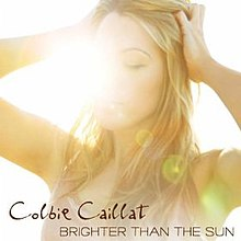 The sun takes over Calliat's face as she grabs her hair.