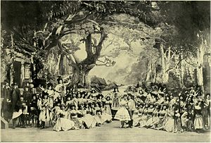 photograph of a ballet presentation on a large stage