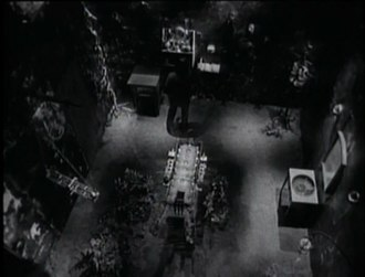 """Broken (1993 film) - The final scene of """"Happiness in Slavery"""". The torture machine can be seen in the center, with Trent Reznor near the far wall"""