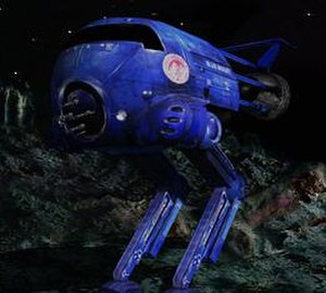 Red Dwarf Remastered - The CG version of Blue Midget, which has arms and legs replacing the caterpillar tracks of the original.