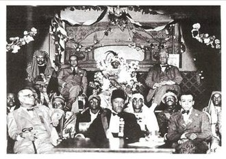 Moorish Science Temple of America - Noble Drew Ali (top center) with Chicago Alderman Louis B. Anderson (to his right) and Congressman Oscar De Priest (left)