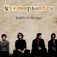 Stereophonics band members sitting alongside each other on a wall. Name of the band and album is written above them against a dull, beige wall.