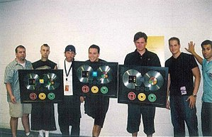 "Take Off Your Pants and Jacket - Blink-182 presented with their RIAA double platinum plaques for ""Take Off Your Pants and Jacket"" in 2002."