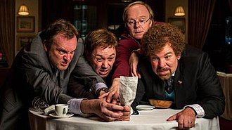 The Bill (Inside No. 9) - Craig (Philip Glenister), Archie (Reece Shearsmith), Kevin (Jason Watkins), and Malcolm (Steve Pemberton) arguing over who should pay for their meal