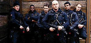 "Ultimate Force - The cast of the first series of Ultimate Force (From L-R): Sergeant Pete Twamley, Corporal Ricky Mann, Corporal Jamie Dow, Staff Sergeant Henry ""Henno"" Garvie, Corporal Alex Leonard and Corporal Jem Poynton."