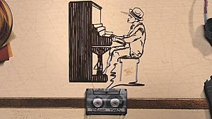 Just the Way You Are (Bruno Mars song) - Bruno Mars arranging himself in a cassette tape in the shape of him playing the piano, in the music video.