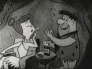 Winston tastes good like a cigarette should - A still photo of a Winston advertisement featuring Fred and Wilma Flintstone. This particular still is from the end-of-show sponsor bumper that aired at the end of every episode while Winston was the show's primary sponsor.