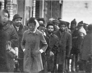 Fred Hampton - Funeral procession for Fred Hampton. Hampton was widely loved in the black Chicago community, and his funeral was attended by over 5,000 people.