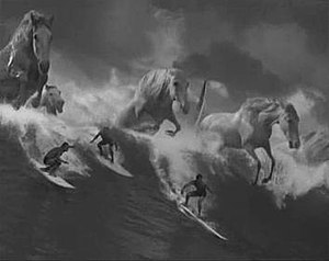 "Surfer (advertisement) - This shot shows the distinctive black and white stock and the metaphor of ""white horses"" illustrating the power of the wave."