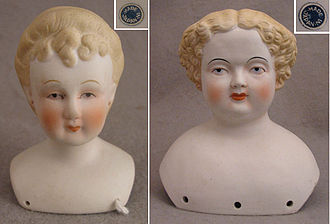 China doll - Mid-20th century labeled Japanese reproduction doll heads, made in both glazed porcelain and Parian, and in both blonde and black hair.