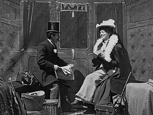 Laura Bayley - Bayley (at right), with George Albert Smith, in The Kiss in the Tunnel (1899)