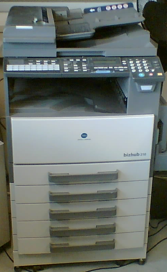 Multi-function printer - A Konica Minolta bizhub 210.  An example of a freestanding SOHO MFP.