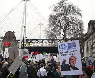 Andrew Lansley - A poster critical of Lansley being carried during the 2011 anti-cuts protest in London.