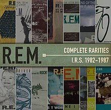 Several R.E.M. album and single covers laid on top of one another
