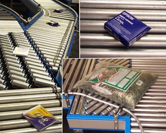 Conveyor system - A lineshaft roller conveyor conveys boxed produce at a distribution center