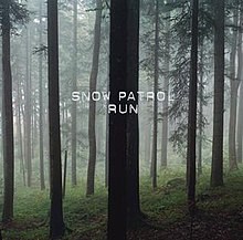 "Photograph of a gloomy forest. The words ""Snow Patrol"" and, below of it, ""Run"" are written centred in white capital letters."
