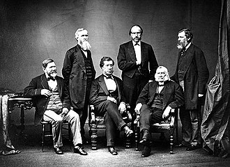 Treaty of Washington (1871) - The American High Commissioners to the Treaty of Washington. U.S. Secretary of State Hamilton Fish served as chairman. Standing: L. to R.: Ebenezer R. Hoar, George Henry Williams, Bancroft Davis. Seated: L. to R.: Robert C. Schenck, Sec. Hamilton Fish, Samuel Nelson.  Brady – 1871