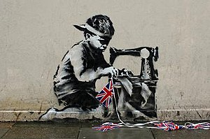 Social commentary - Banksy's 'slave labour' shows a young child doing the work of an adult. Hence, the child is being robbed of his childhood.