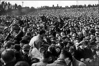 Burnden Park disaster - Women and children being passed over the heads of others at the Railway End during the crush
