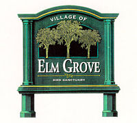 Road sign greeting motorists entering Elm Grove