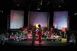 Thrust stage - A production of Godspell performed on a 3/4 thrust stage