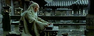 Xu Kuanghua playing an ancient qin in the film, Hero.