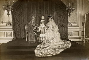 Coronation photograph of Zita as Queen of Hungary, with her husband, King Charles IV and Crown Prince Otto between them.Photo: 31 December 1916
