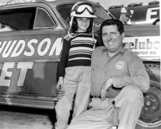Marshall Teague (racing driver) - Marshall Teague beside the Fabulous Hudson Hornet with his daughter at the Daytona Beach Road Course in 1952