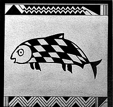 Photo of square side of pottery showing fish with skewed checkered pattern on its skin. Zig-zag lines represent waves at the top and bottom.