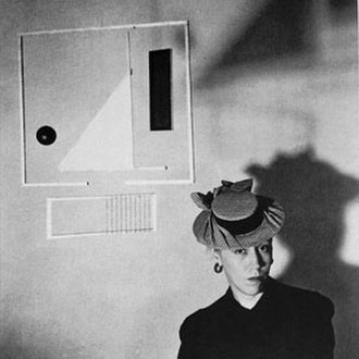 Xenia Cage - Xenia with one of her wood-frame and rice-paper mobiles, circa 1943.