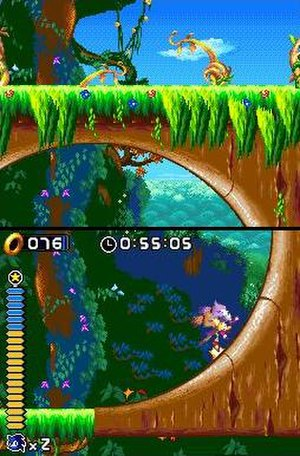 Sonic Rush - Blaze runs through a loop in an early level of the game, demonstrating the dual-screen feature.