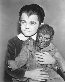 "Eddie Munster with his werewolf doll ""Woof-Woof""."