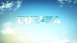 "The title of the series, ""Eureka"", spelled out in semi-transparent letters, on a background of blue sky and clouds"