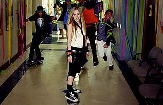 Here's to Never Growing Up - Lavigne referred the Let Go era while skateboarding wearing a tie.