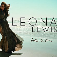 "A brunette woman is standing in front of a beach. She is wearing a greenish dress and she grabs her neck with her left arm. Next to her image, the words ""Leona Lewis"" are written in black capital letters, and ""Better In Time"" in dark brown italics."