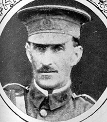 A portrait of a soldier in a peaked cap